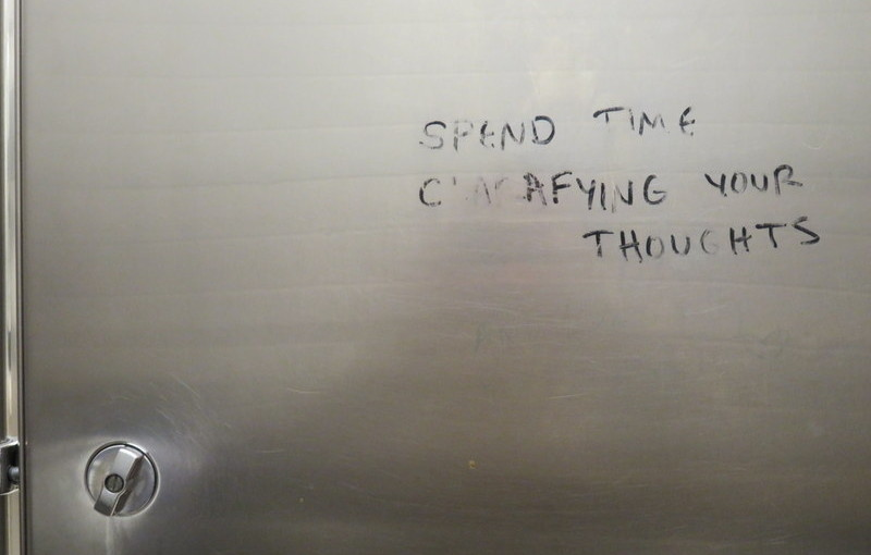 Instructive graffito in Powell's bathroom