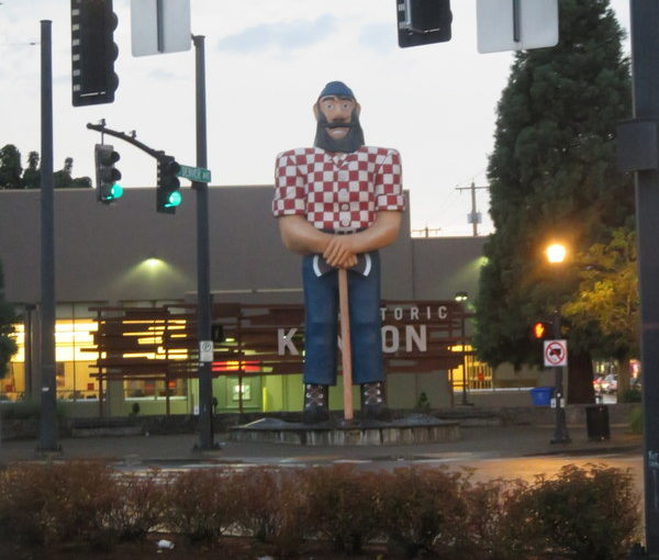 Paul Bunyan on a rainy evening, from a vantage point just outside the strip club.